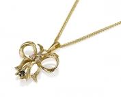 תליון זהב לנשים בצורת פפיון משובץ יהלומים וספיר
