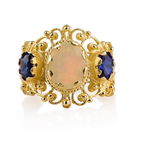 טבעת זהב מעוטרת בשיבוץ אבני מונסטון וספיר זירקון
